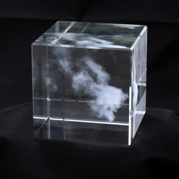 Clear glass cube—approximately 4 inches—with one horizontal and one vertical line etched into each side. The cube looks like it contains a cloud floating in the center.