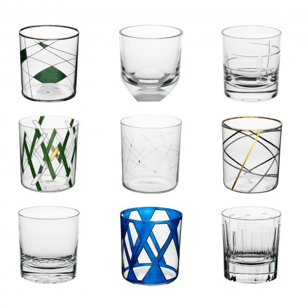 Nine double old-fashioned whiskey tumblers. Each is cut, engraved, polished, sandblasted, painted, or gilded with patterns that range from subtle and clear to bright blue.