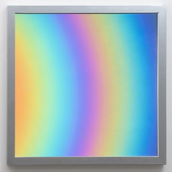 Diptych with iridescent rainbows radiating out in two half circles. The glass panels are framed in thin aluminum frames and hang on a white wall.