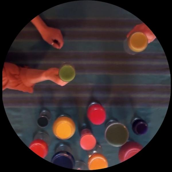 "A round photo shows, from above, a woman's hands reaching in from the left; her right hand holds a green glass. A hand holding a yellow glass is at the top right. At the bottom are 10 glasses of various colors. Text on the black background says, ""They raise their glasses."""